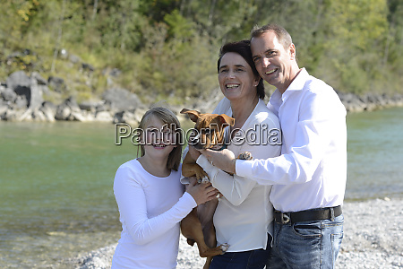 happy family with a dog at