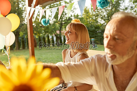 happy woman and senior man on