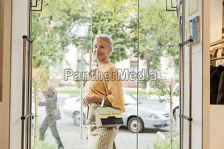 smiling senior woman walking along a