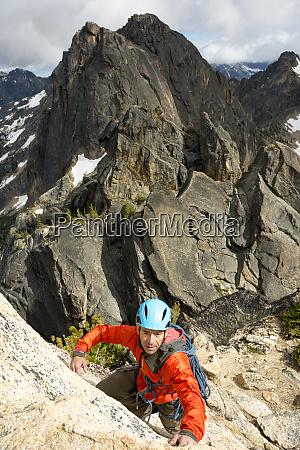 a man rock climbing the beckey