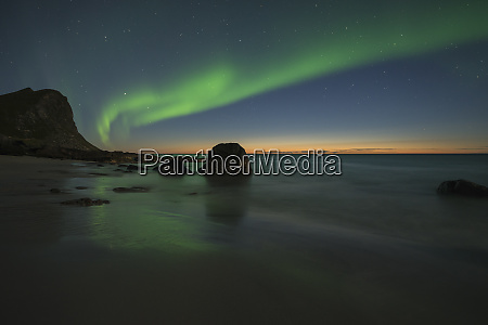 majestic landscape with aurora borealis over