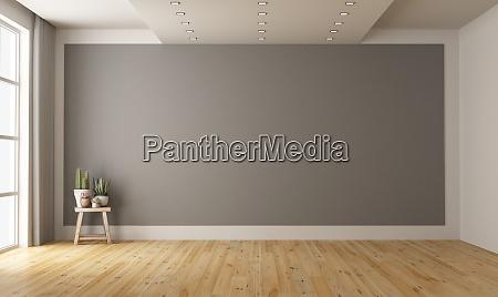 pusty minimalistyczny pokoj z szara sciana