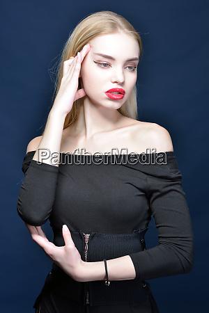 beautiful blonde woman in a black