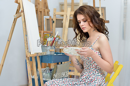 woman with easel palette and brush