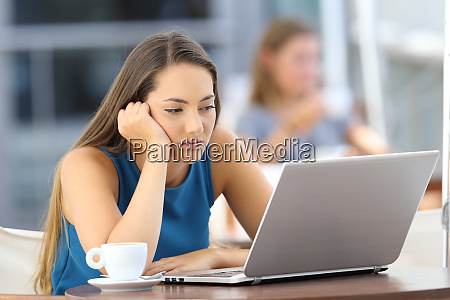 bored woman watching on line content