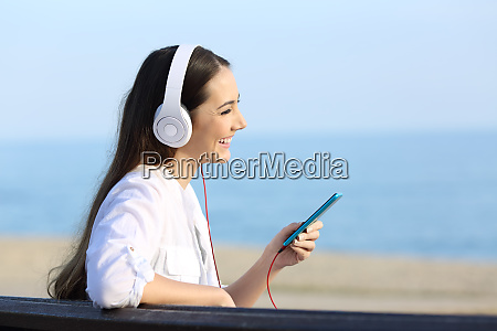 profile of a girl listening to