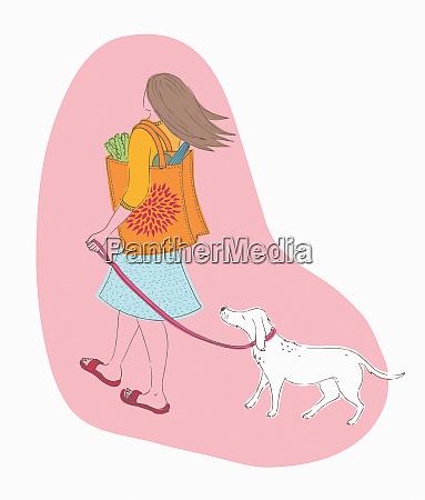 woman carrying shopping in reusable bag