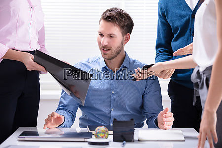 young businessman looking at document
