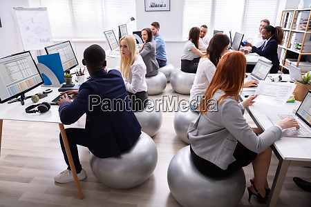 group of businesspeople discussing while working