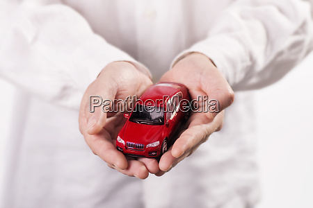 hands holding a car