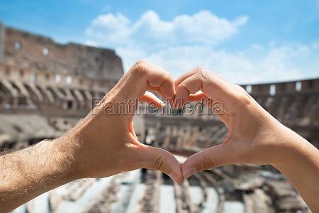 couple making heart shape inside of