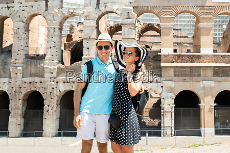 young couple standing in front of