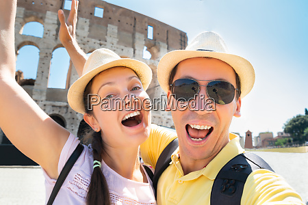 couple taking selfie in front of