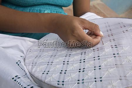cuba trinidad hands embroidering in market