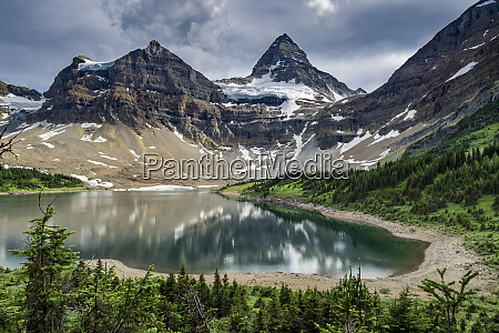 mount assiniboine and glacier above a