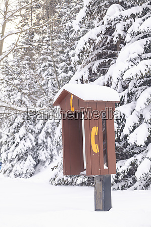telephone booth with fresh snow near