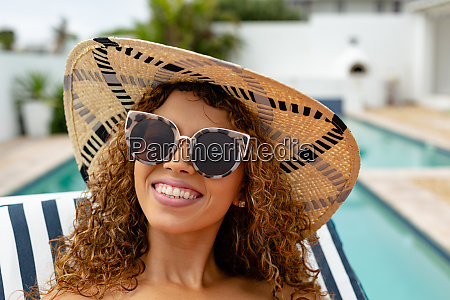 happy woman relaxing on a sun