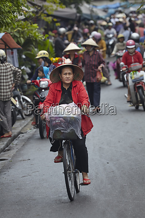 vietnamese woman with conical hat on