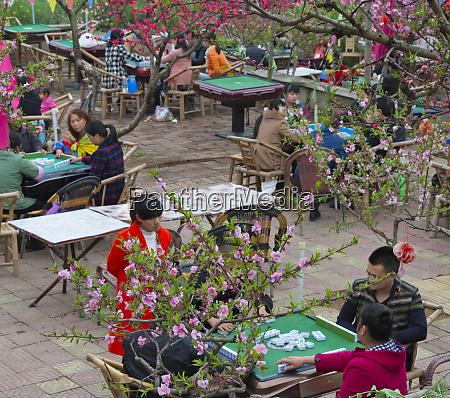 women playing mahjong on the street