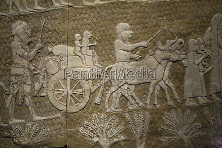 stone mural telling the story of
