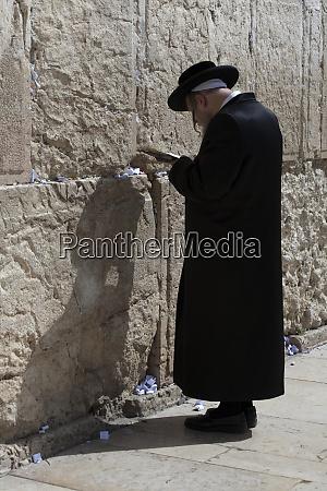 elderly jewish worshipper in prayer at