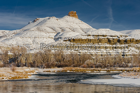 cottonwood trees and green river in