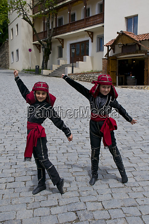 young traditionally dressed georgian girls sighnaghi