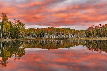 red jack lake and sunrise reflection
