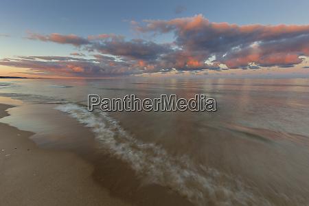 sunrise clouds over lake michigan in