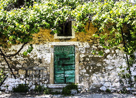 corfu greece green latched door and