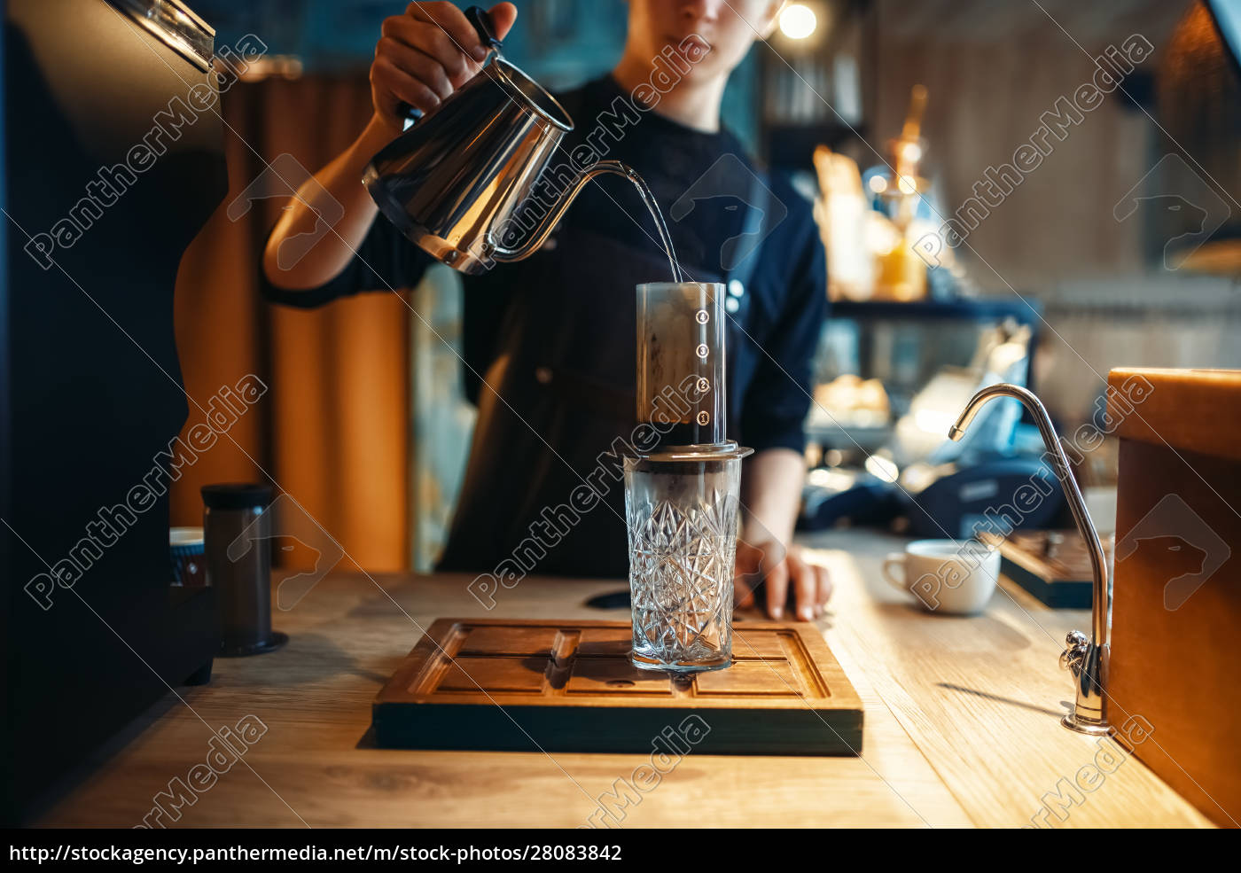 barista, pours, water, from, coffee, pot - 28083842