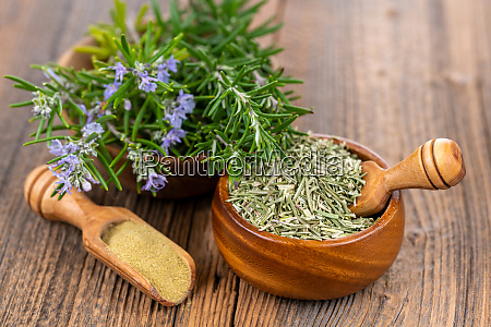 a wooden bowl with blooming and