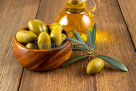 green olives with olive branch in