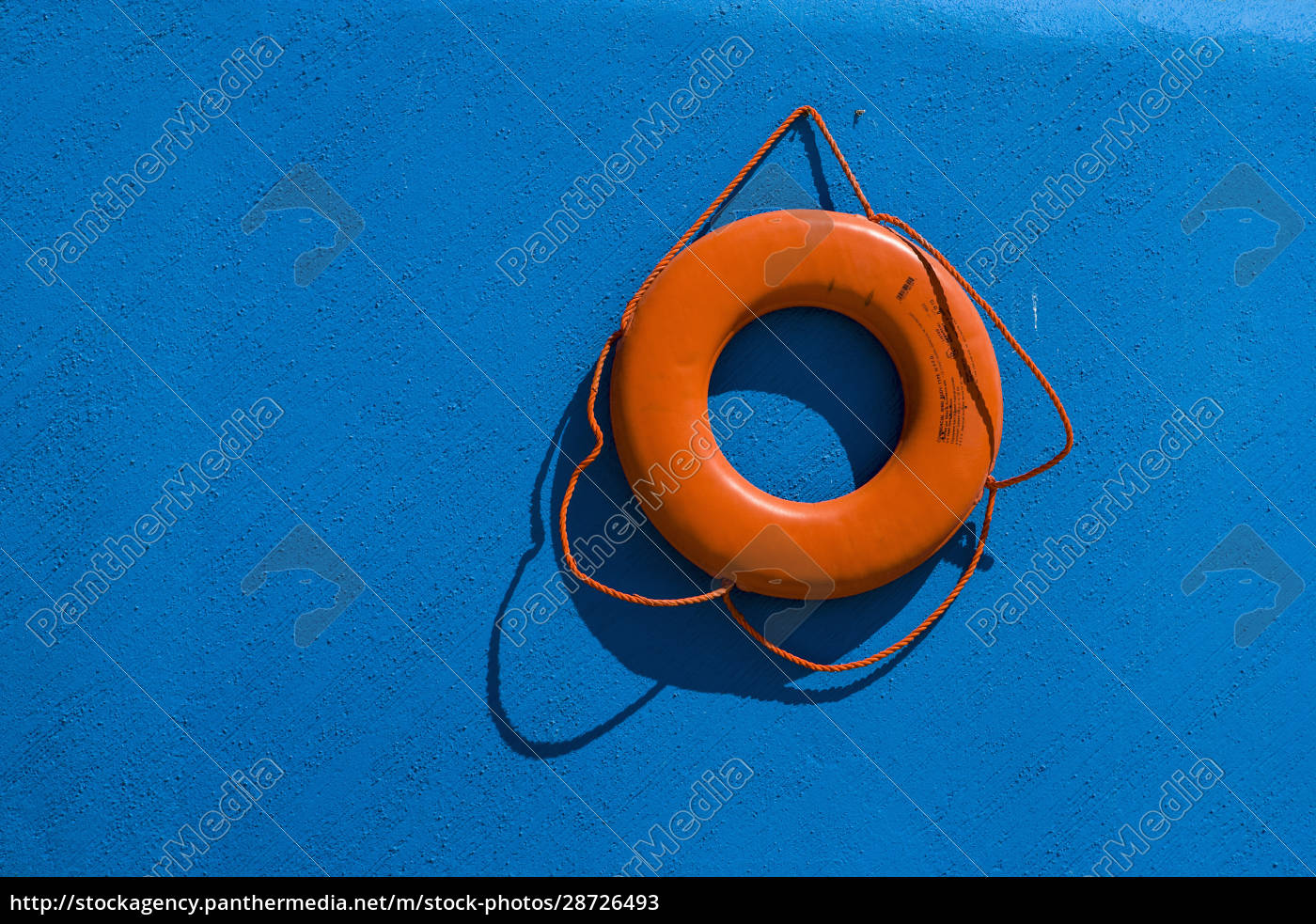 red, life, preserver, against, blue, wall - 28726493