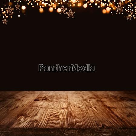drewniane tlo z gwiazdami swiatecznymi