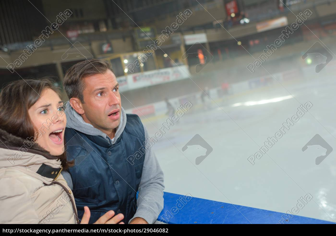 anxious, couple, watching, game, on, ice - 29046082